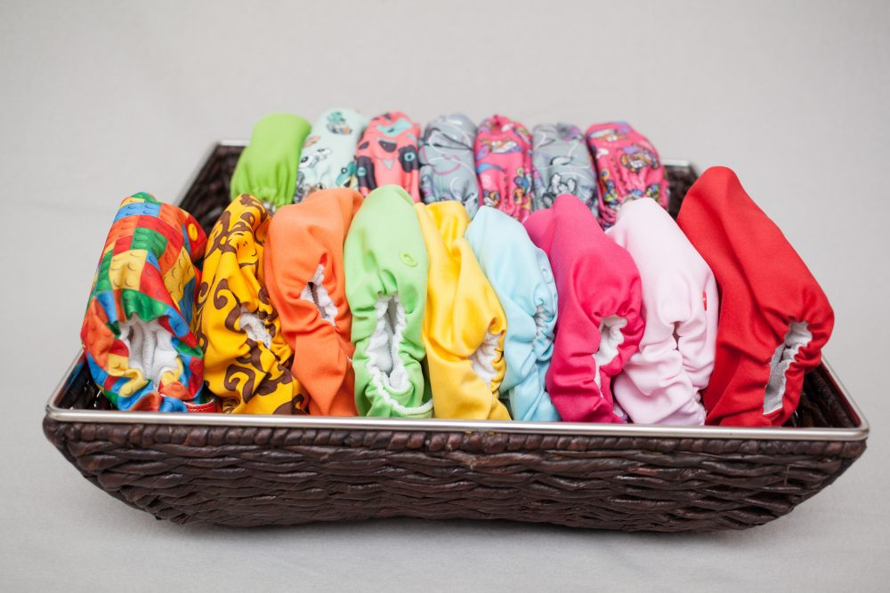 A lot of cloth diapers in a basket