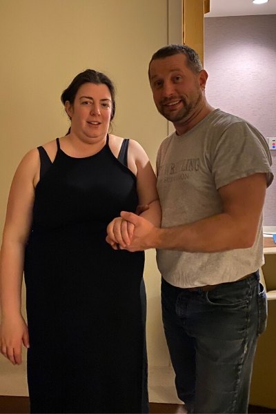 Husband and Wife standing beside eachother & holding hands in the early stages of labor.